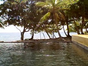 View of Bay Island Honduras beach beyond the infinity pool